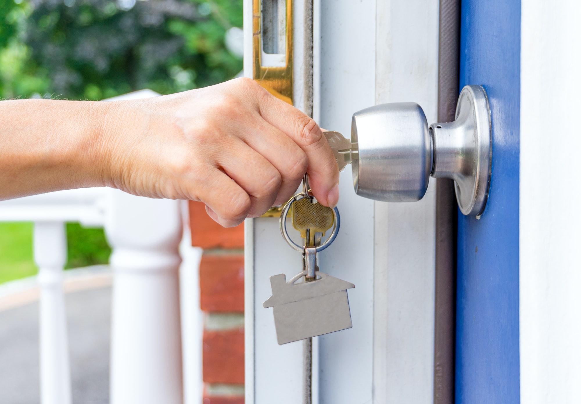 home owner using a key open the door